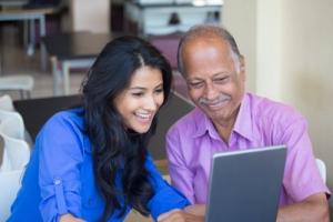 an elderly man and caregiver